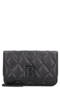 B. leather wallet on chain, Clutch Balenciaga woman
